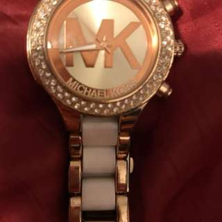 Round clear gemstone encrusted michael kors analog watch with gold-colored link band