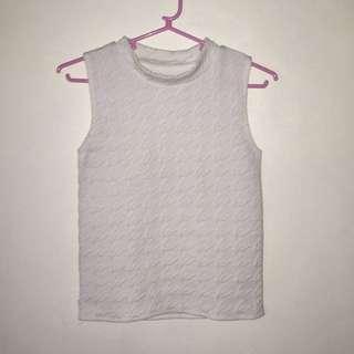 White turtleneck sleeveless shirt