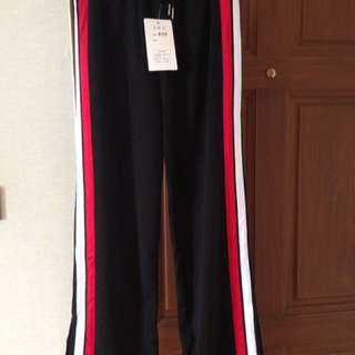 Jogging pants with red and white stripes