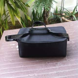 Black cosmetic bag. Seldom use and in good condition. Dimension 30 x 15 x 14cm.