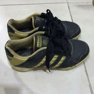 Adidas Black and Gold shoes