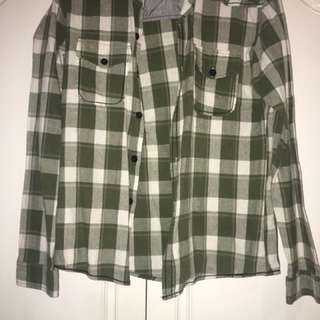 Green long-sleeved flannel polo