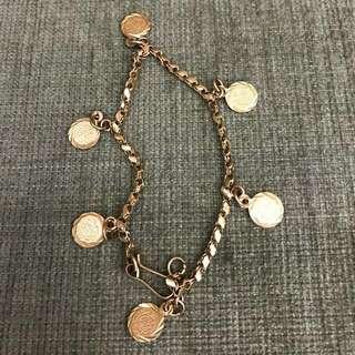 21k 6- charm bracelet 12.0 grams
