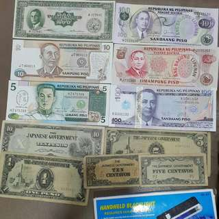 Various Banknotes with handheld UV light