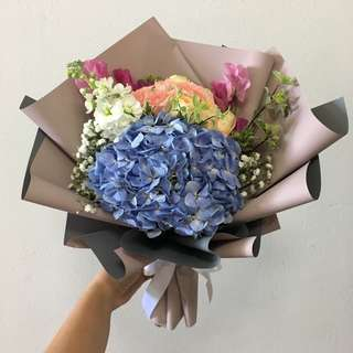 Anniversary Bouquet in Blue Hydrangeas with Peach Roses and Mix fillers