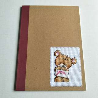 Completed Handmade Cross Stitch - Cookie Bear, on Notebook