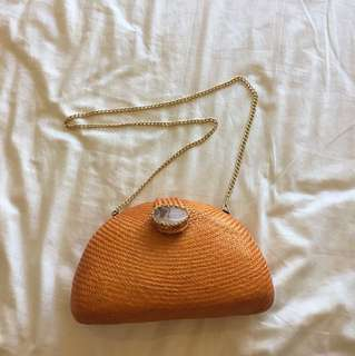 Orange purse with gold chain