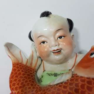 """NIAN NIAN YU YUE""   BOY WITH CARP SCULPTURE.   W=8"",  D=7"", & H=10""."