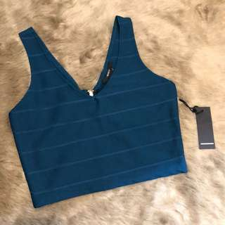 green zip up bandage top