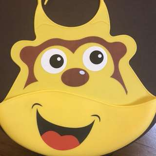 Monkey silicone bib with scoop pocket by Nuby