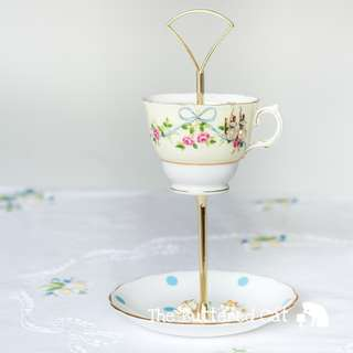 Vintage teacup trinket and jewelry stand, pretty blue ribbon bows and pink roses