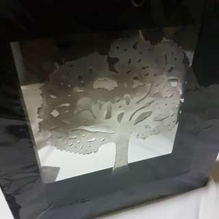 Silver tree in a frame