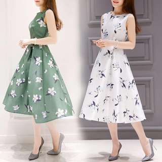 Long sleeveless flowery pattern dress with flare bottoms; woman women female ladies; formal dinner party event work office;