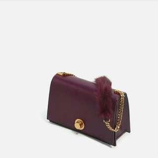 fur sling bag charles and keith