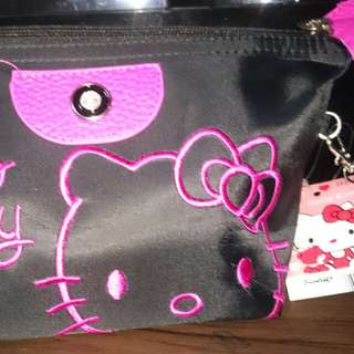 On hand hello kitty cosmetic pouch