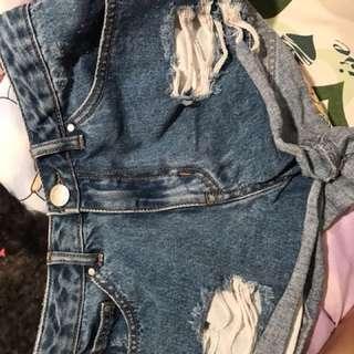 Blue denim distressed shorts