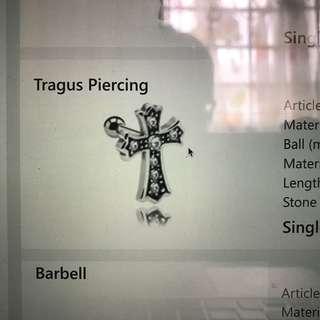 Cross Tragus Piercing