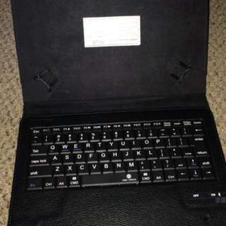 Black tablet case with wireless and detachable keyboard
