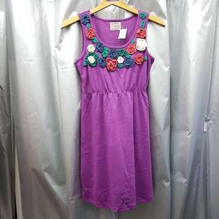 Purple dress with crochet flowers