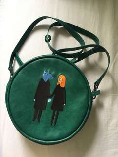Circle embroidered green bag