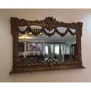 Mirror with gold leaf embossed designs