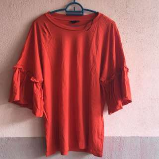 Bright red orange top