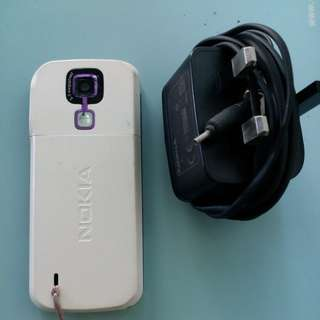 Nokia hand phone with camera, charger & ear phone