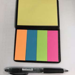 Post-it notes in faux leather folder.