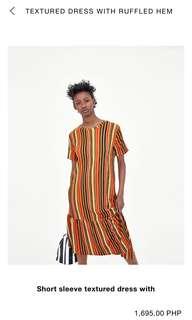 Textured Dress with ruffled hem