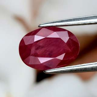 1.63ct Oval Natural Orangey Red Sapphire