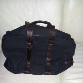 Travel bag with leather