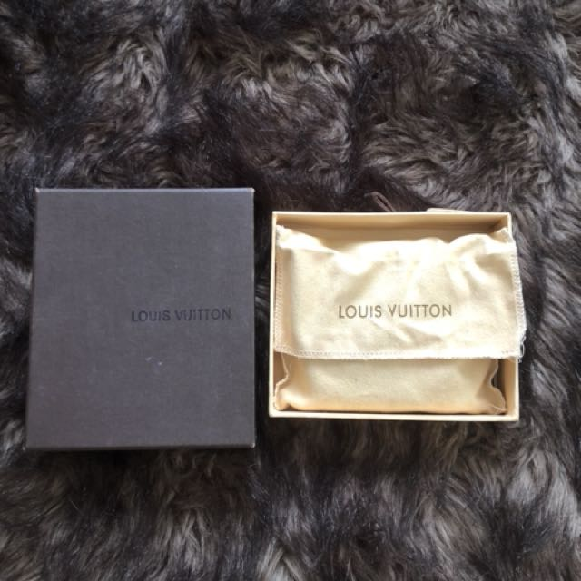 NEVER USED AUTHENTIC LV COIN PURSE