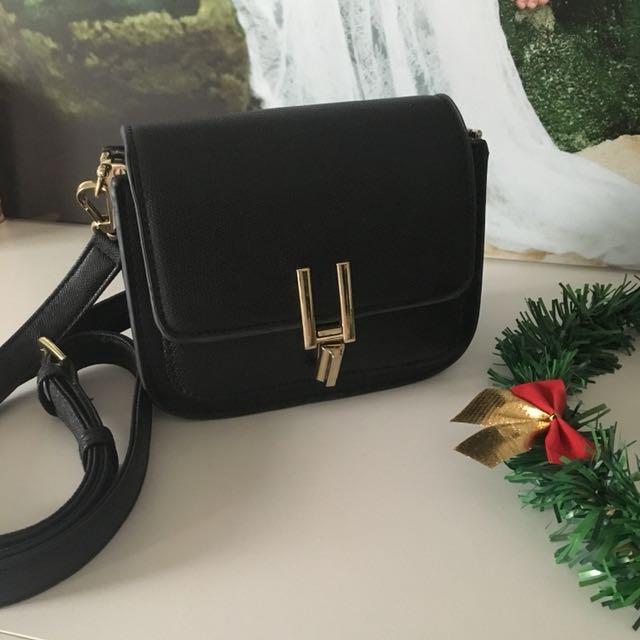 Small black sling bag