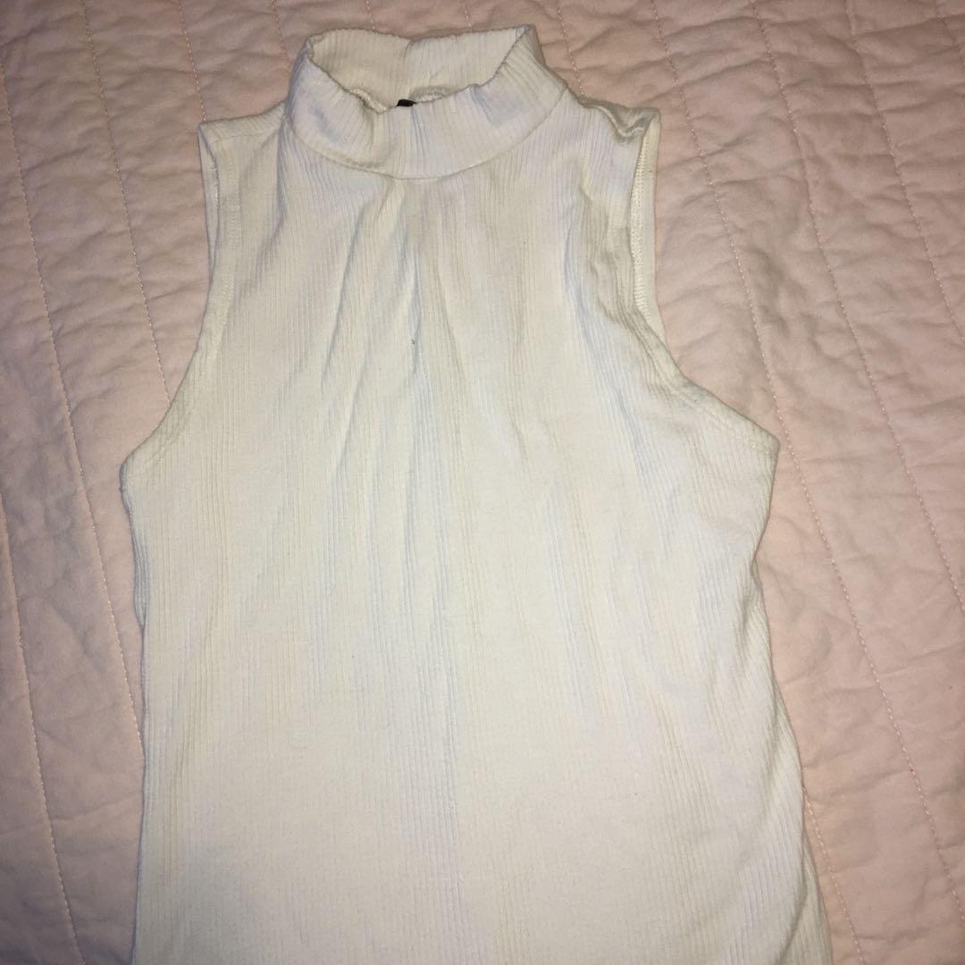 White sleeveless turtleneck bodysuit