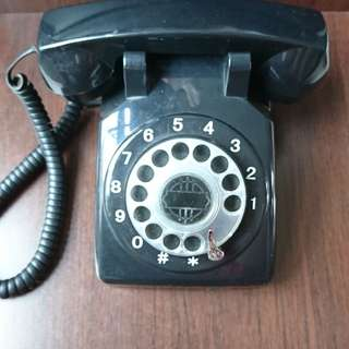 Black rotary dial telephone