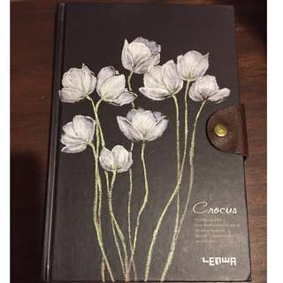 Hardcover notebook with button closure