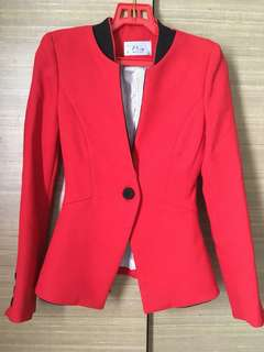 Stylish red blazer with black trimming
