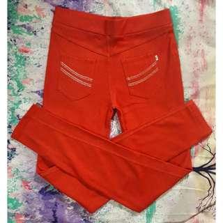 Celana legging merah