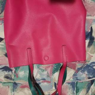 Pink bag (Sorry for upside down pic) has a small black stain