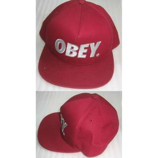 """red Jockey cap with """"OBEY"""" embroidered"""