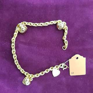 916 Gold bracelet with charm