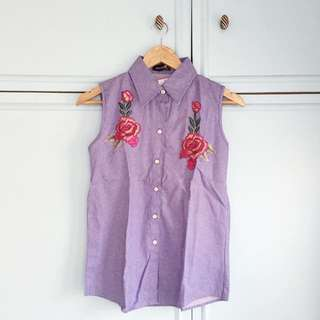 Sleeveless floral shirt