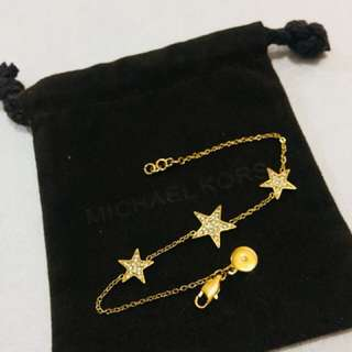 Micheal Kors gold star bracelet