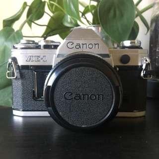 Canon AE-1 body with broken lens (frozen aperture)