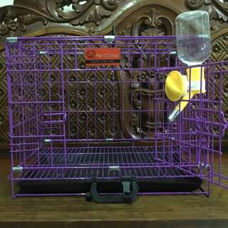 Dog cage with water bottle