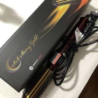 Hair comb curler