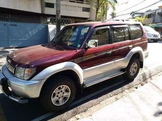 Land Cruiser Prado Maroon Gasoline