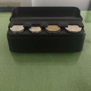 Spring coin dispenser