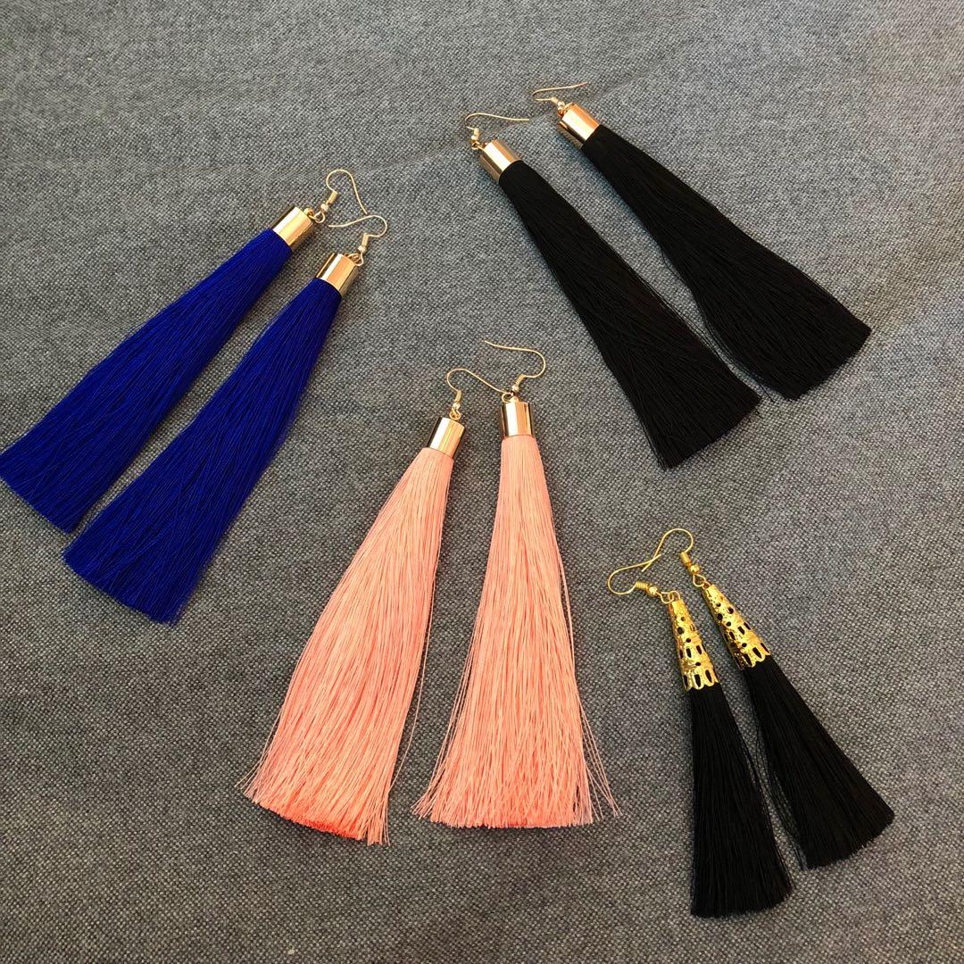 Brand new elegant tasseled earrings in pink, black and dark blue