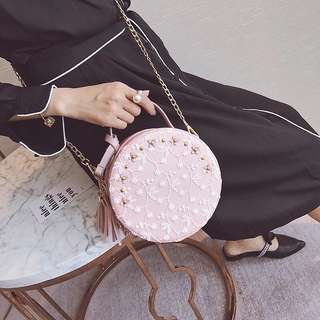 Circular laced sling bag